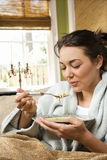 Jonge Vrouw die Soep eet Stock Foto's