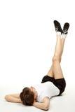 Jonge vrouw die sportoefeningen doet Royalty-vrije Stock Fotografie