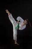 Jonge Vrouw die Tae Kwon Do High Kick uitvoert Royalty-vrije Stock Fotografie
