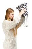 Jonge vrouw die uit haar zak in onderzoek schudden Stock Foto's