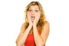 Jonge vrouw die verrast kijkt Stock Fotografie
