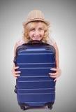 Jonge vrouw die voor vakantie voorbereidingen treffen royalty-vrije stock afbeelding