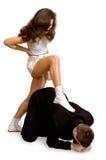 Jonge vrouw die zich op een rug van een geïsoleerdee man bevindt royalty-vrije stock afbeelding
