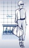Jonge vrouw in een luchthaven die een reiszak houden Royalty-vrije Stock Afbeelding
