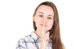 Jonge vrouw een stil gebaar op witte achtergrond royalty-vrije stock fotografie