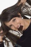 jonge vrouw en chocolade Stock Afbeeldingen