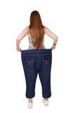 Jonge vrouw gelukkig van geïsoleerde het dieetresultaten van het gewichtsverlies, Stock Foto's