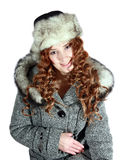 Jonge vrouw in grijze laag en stock fotografie