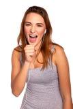 Jonge vrouw het luisteren muziek en het onderhouden Stock Fotografie