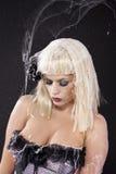 Jonge vrouw in het spinneweb Stock Foto