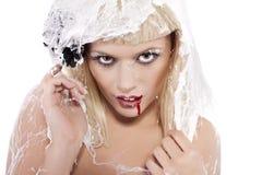 Jonge vrouw in het spinneweb Stock Foto's