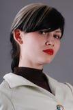 Jonge vrouw in kostuum royalty-vrije stock afbeelding