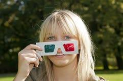 Jonge vrouw met 3D-glazen Stock Afbeeldingen