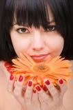 Jonge vrouw met bloem royalty-vrije stock foto
