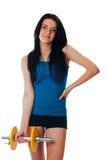Jonge vrouw met een dumbell royalty-vrije stock afbeeldingen