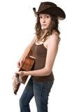 Jonge vrouw met een gitaar Stock Foto's