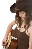 Jonge vrouw met een gitaar Royalty-vrije Stock Foto's
