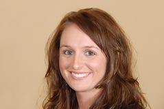 Jonge vrouw met een glimlach stock afbeeldingen
