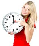 Jonge vrouw met een klok Het Concept van het tijdbeheer Royalty-vrije Stock Afbeeldingen