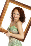Jonge vrouw met een omlijsting Royalty-vrije Stock Foto's