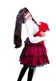 Jonge vrouw met een rood stuk speelgoed Stock Afbeeldingen