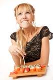 Jonge vrouw met eetstokjes royalty-vrije stock afbeelding