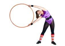 Jonge vrouw met gymnastiekring Stock Foto