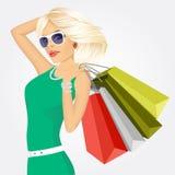 Jonge vrouw met het winkelen zakken royalty-vrije illustratie