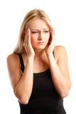 Jonge vrouw met hoofdpijn Stock Foto's