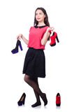 Jonge vrouw met keus van schoenen Royalty-vrije Stock Foto's