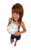 Jonge vrouw met klok Royalty-vrije Stock Foto's