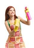 Jonge vrouw met nevelfles en spons Royalty-vrije Stock Foto's