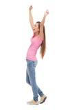 Jonge vrouw met opgeheven wapens Stock Fotografie