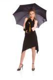 Jonge vrouw met paraplu Stock Foto's