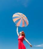 Jonge vrouw met paraplu Royalty-vrije Stock Foto's
