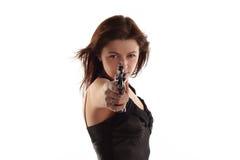 Jonge vrouw met revolver Royalty-vrije Stock Foto's