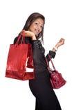 Jonge vrouw met rode het winkelen zak Stock Foto's