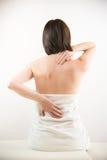 Jonge vrouw met rugpijn Stock Fotografie