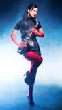 Jonge vrouw met saxofoon Stock Afbeeldingen