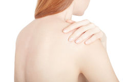 Jonge vrouw met schouderpijn, het knippen weg Stock Fotografie