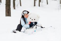 Jonge vrouw met snowboard Royalty-vrije Stock Foto's