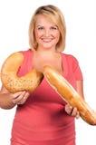 Jonge vrouw met vers brood royalty-vrije stock afbeelding