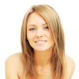 Jonge vrouw met vriendschappelijke glimlach Stock Foto's