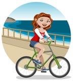 Jonge vrouw op fiets Royalty-vrije Stock Afbeelding