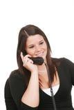 Jonge vrouw op telefoon Stock Afbeelding