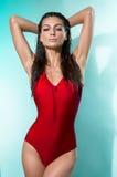 Jonge vrouw in rode sexy bodysuit royalty-vrije stock foto