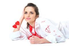 Jonge vrouw in romantische stemming, die op wit wordt geïsoleerdr Stock Foto's