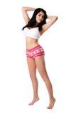 Jonge vrouw in witte ondergoed het uitrekken zich tiptoe Royalty-vrije Stock Fotografie