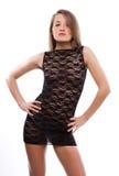 Jonge vrouw in zwarte kleding Royalty-vrije Stock Afbeelding