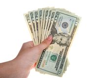 Jonge vrouwelijke hand die 20 dollarsrekeningen gewaaid houden uit stock foto's